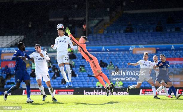Rodrigo of Leeds United headers the ball, as Illan Meslier of Leeds United looks to punch th eb during the Premier League match between Leeds United...