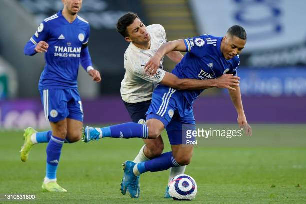 Rodrigo of Manchester City and Youri Tielemans of Leicester City battle for possession during the Premier League match between Leicester City and...