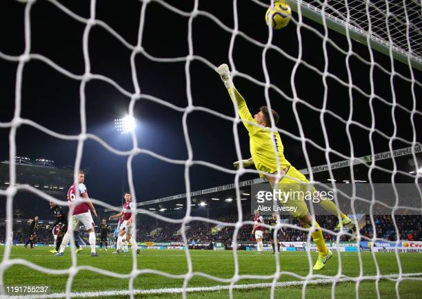 Rodrigo of Manchester City beats Nick Pope of Burnley to score their third goal during the Premier League match between Burnley FC and Manchester...