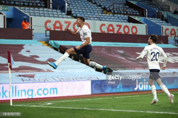 Rodrigo of Manchester City celebrates after scoring their side's second goal with team mate Bernardo Silva during the Premier League match between...
