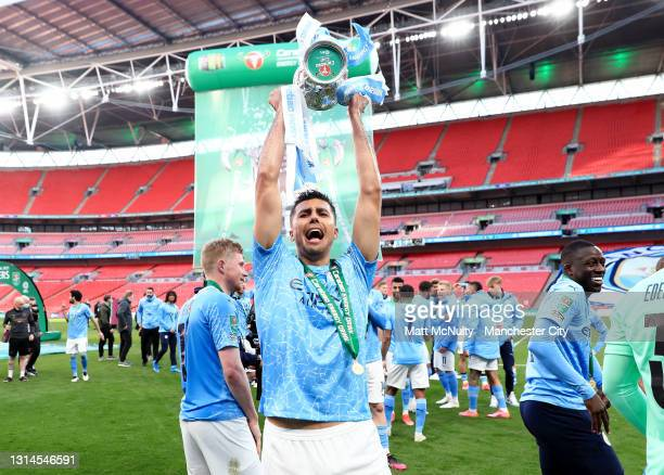 Rodrigo of Manchester City celebrates with the trophy during the Carabao Cup Final between Manchester City and Tottenham Hotspur at Wembley Stadium...