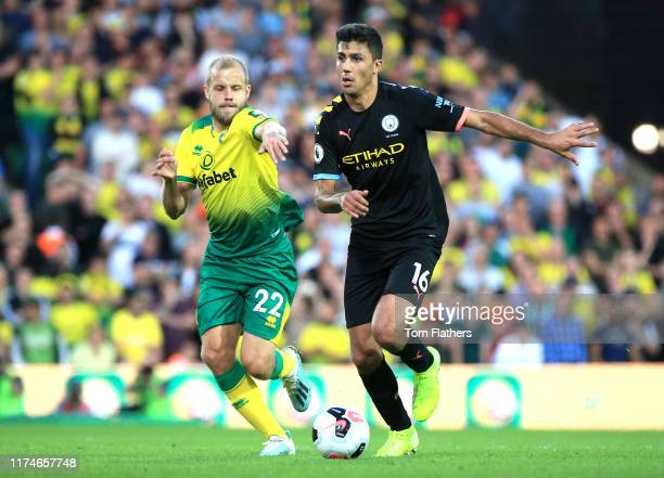 Rodrigo of Manchester City is challenged by Teemu Pukki of Norwich City during the Premier League match between Norwich City and Manchester City at...