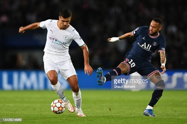 Rodrigo of Manchester City looks to break away from Neymar of Paris Saint-Germain during the UEFA Champions League group A match between Paris...