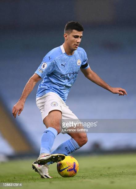 Rodrigo of Manchester City runs with the ball during the Premier League match between Manchester City and Burnley at Etihad Stadium on November 28...