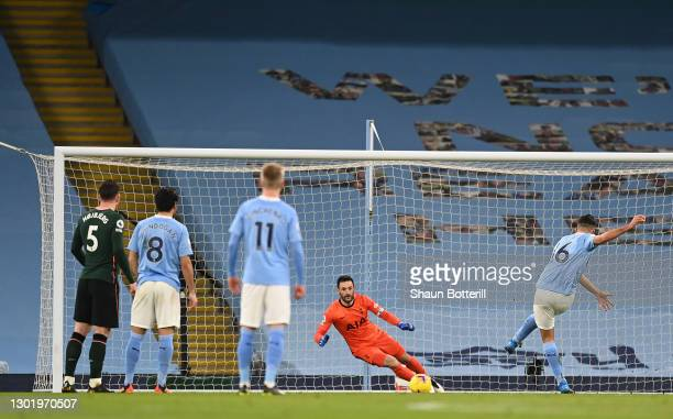 Rodrigo of Manchester City scores their side's first goal from the penalty spot past Hugo Lloris of Tottenham Hotspur during the Premier League match...