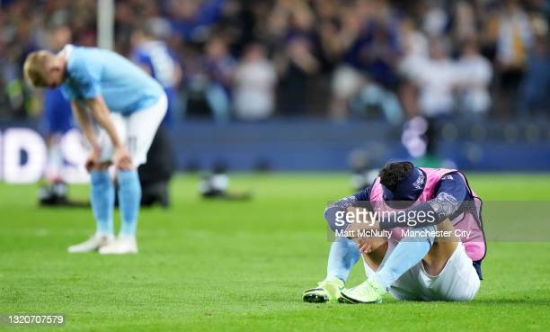 Rodrigo of Manchester City sits on the pitch dejected following loss in the UEFA Champions League Final between Manchester City and Chelsea FC at...