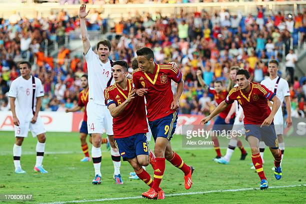 Rodrigo of Spain celebrates his team's first goal with team mates Marc Bartra and Koke during the UEFA European U21 Championship Semi Final match...