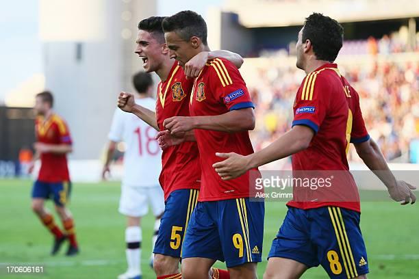 Rodrigo of Spain celebrates his team's first goal with team mates Marc Bartra and Koke during the UEFA European U21 Championship Semi Final match...