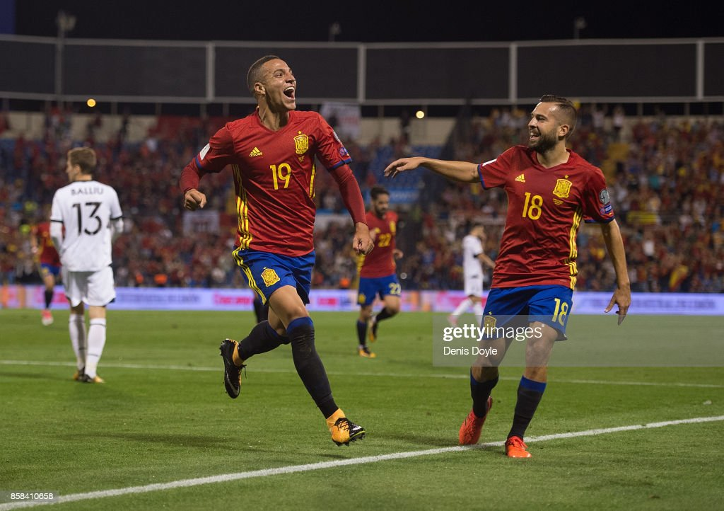 Rodrigo of Spain celebrates its Jordi Alba of Spain after scoring Spain opening goal during the FIFA 2018 World Cup Qualifier between Spain and Albania at Estadio Jose Rico Perez on October 6, 2017 in Alicante, Spain.