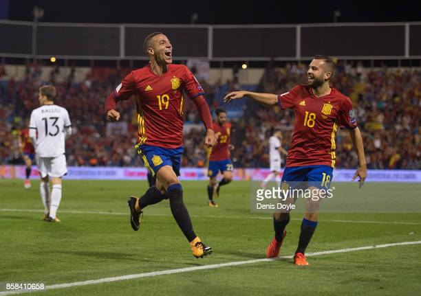 Rodrigo of Spain celebrates its Jordi Alba of Spain after scoring Spain opening goal during the FIFA 2018 World Cup Qualifier between Spain and...