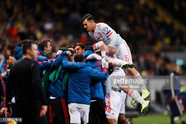 Rodrigo of Spain celebrates with team mates after scoring to 1-1 during the UEFA Euro 2020 qualifier between Sweden and Spain at Friends arena on...