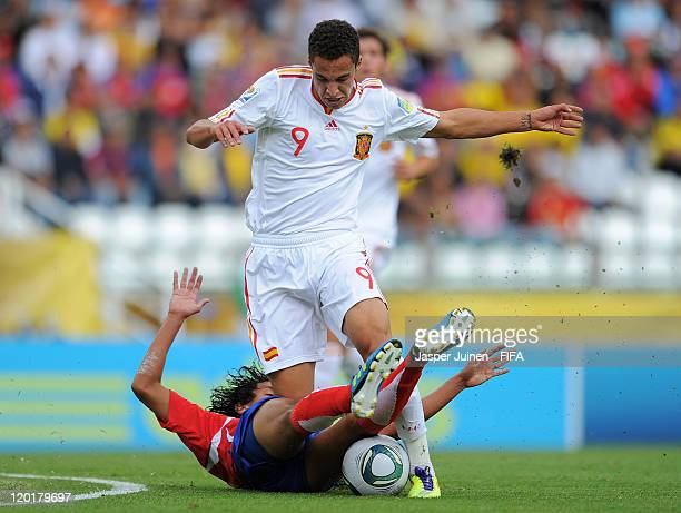 Rodrigo of Spain is fouled by Yeltsin Tejeda of Costa Rica during the FIFA U-20 World Cup Colombia 2011 group C match between Costa Rica and Spain at...