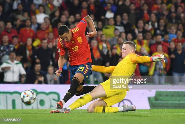 Rodrigo of Spain is tackled by Jordan Pickford of England during the UEFA Nations League A Group Four match between Spain and England at Estadio...