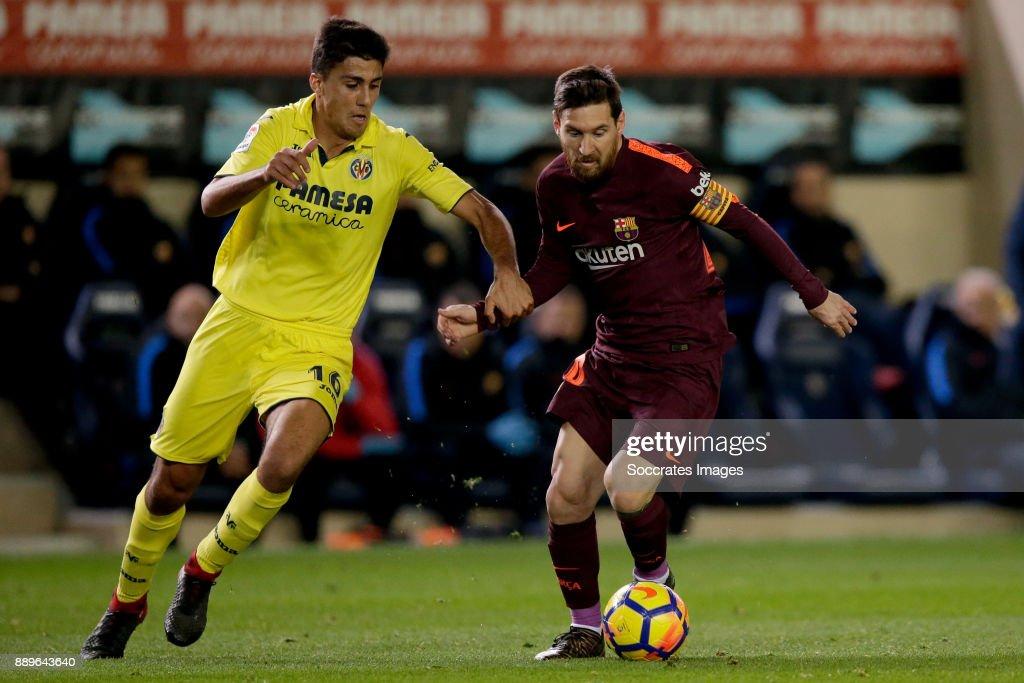 Rodrigo of Villarreal, Lionel Messi of FC Barcelona during the Spanish Primera Division match between Villarreal v FC Barcelona at the Estadio de la Ceramica on December 10, 2017 in Castellon Spain