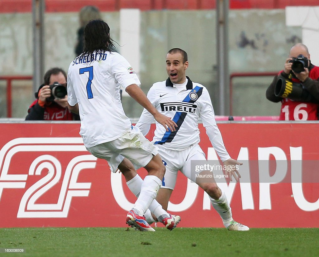 Rodrigo Palacio (R) and Ezequiel Schelotto of FC Internazionale celebrate the victory goal during the Serie A match between Calcio Catania and FC Internazionale Milano at Stadio Angelo Massimino on March 3, 2013 in Catania, Italy.