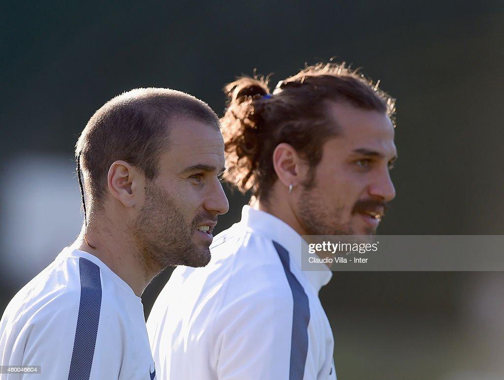 Rodrigo Palacio (L) and Pablo Daniel Osvaldo during FC Internazionale Training Session at Appiano Gentile on December 06, 2014 in Como, Italy.