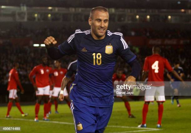 Rodrigo Palacio of Argentina celebrates after scoring the opening goal during a FIFA friendly match between Argentina and Trinidad & Tobago at...
