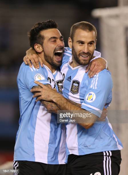Rodrigo Palacio of Argentina celebrates with teammate Ezequiel Lavezzi after scoring during a match between Argentina and Peru as part of the 17th...