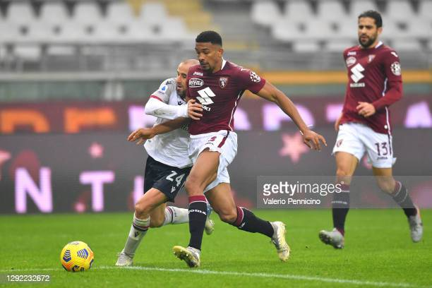 Rodrigo Palacio of Bologna battles for possession with Bremer of Torino during the Serie A match between Torino FC and Bologna FC at Stadio Olimpico...