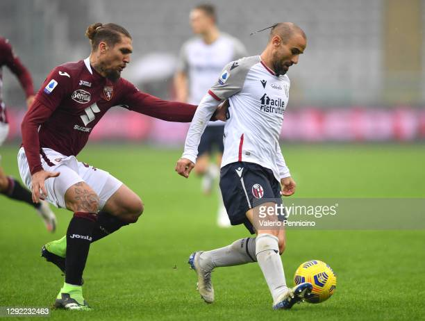 Rodrigo Palacio of Bologna battles for possession with Lyanco of Torino during the Serie A match between Torino FC and Bologna FC at Stadio Olimpico...