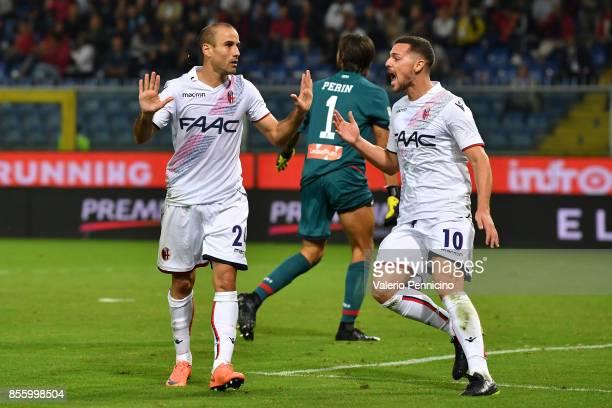 Rodrigo Palacio of Bologna FC celebrates after scoring the opening goal with team mate MattiaÊDestro during the Serie A match between Genoa CFC and...