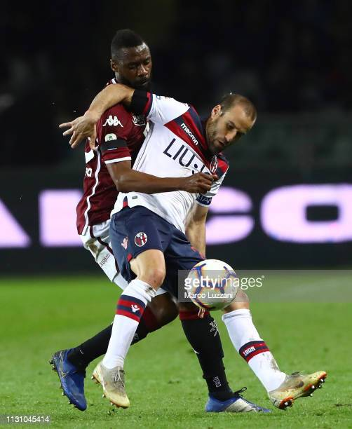 Rodrigo Palacio of Bologna FC competes for the ball with Nicolas Nkoulou of Torino FC during the Serie A match between Torino FC and Bologna FC at...