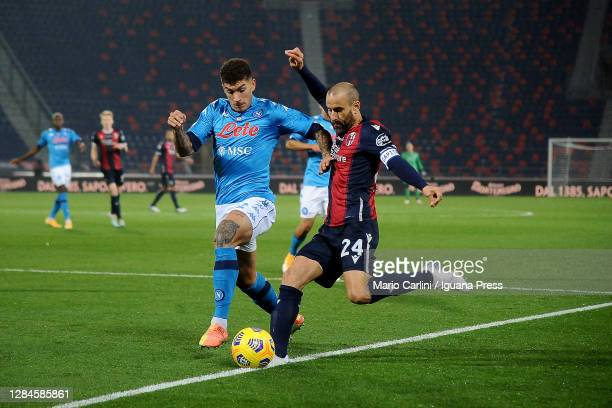 Rodrigo Palacio of Bologna FC comptes the ball with Giovanni De Lorenzo of SSC Napoli during the Serie A match between Bologna FC and SSC Napoli at...