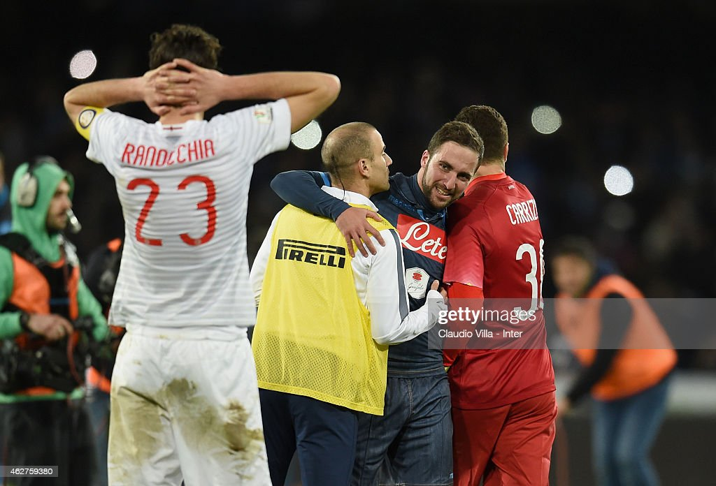 Rodrigo Palacio of FC Internazionale and Gonzalo Higuain of SSC Napoli (C) at the end of the TIM Cup match between SSC Napoli and FC Internazionale at Stadio San Paolo on February 4, 2015 in Naples, Italy.