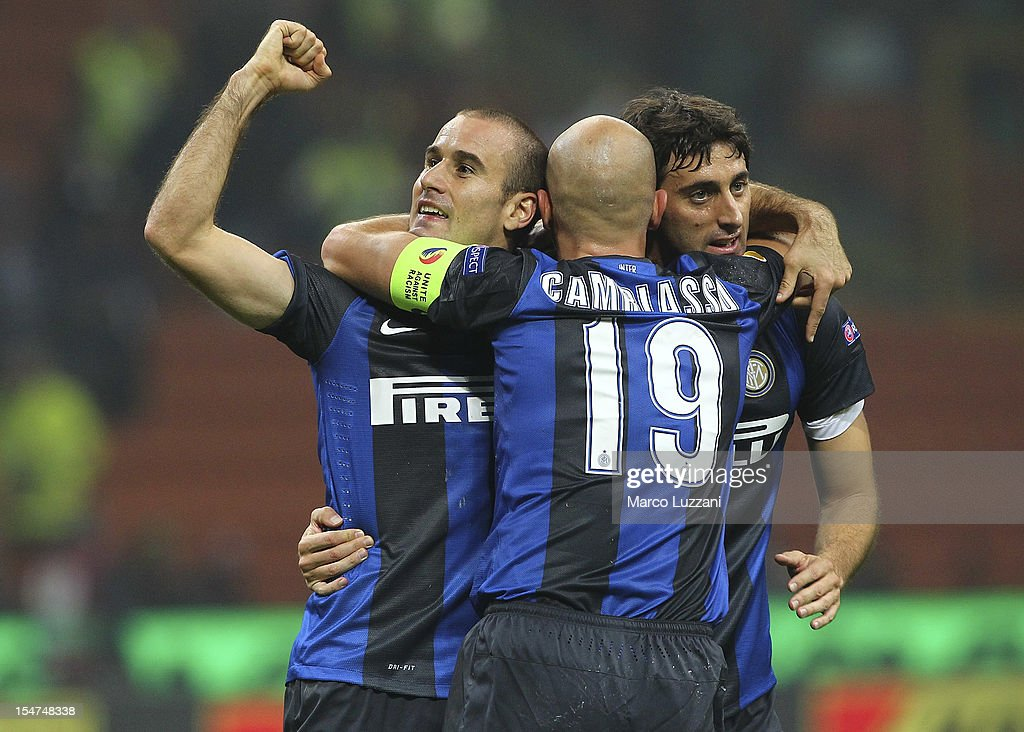 Rodrigo Palacio (L) of FC Internazionale Milano celebrates with his team-mate Esteban Cambiasso (C) and Diego Alberto Milito (R) after scoring the opening goal during the UEFA Europa League group H match between FC Internazionale Milano and FK Partizan on October 25, 2012 in Milan, Italy.