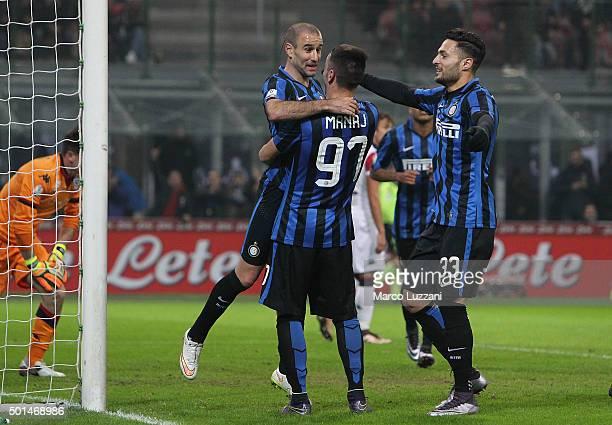 Rodrigo Palacio of FC Internazionale Milano celebrates with his teammates Rey Manaj and Danilo D Ambrosio after scoring the opening goal during the...