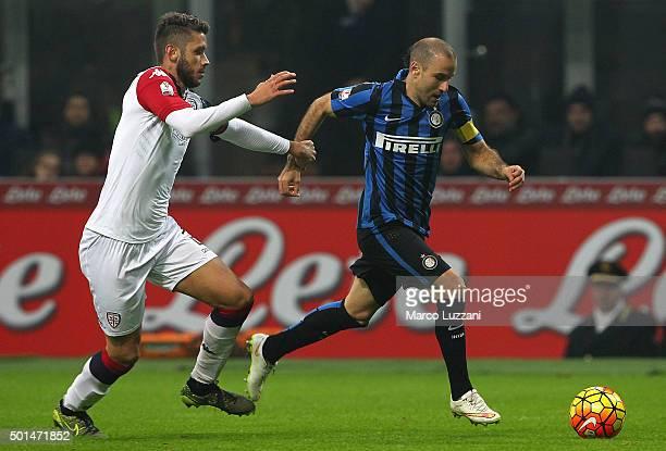 Rodrigo Palacio of FC Internazionale Milano is challenged by Simone Benedetti of Cagliari Calcio during the TIM Cup match between FC Internazionale...