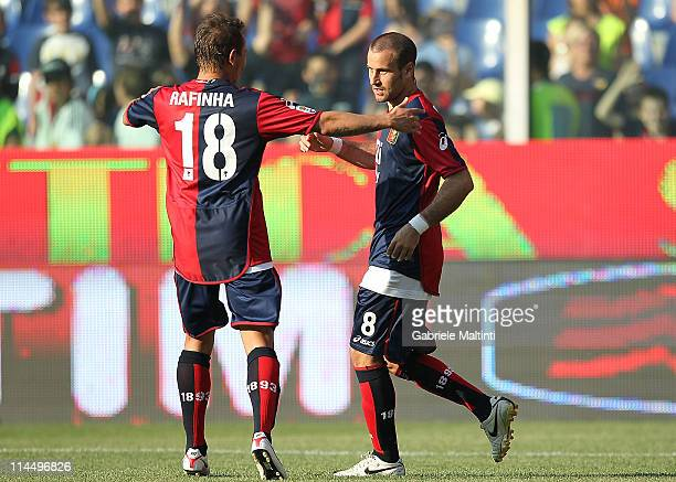 Rodrigo Palacio of Genoa CFC celebrates with team-mate Rafinha after scoring a goal during the Serie A match between Genoa CFC and AC Cesena at...