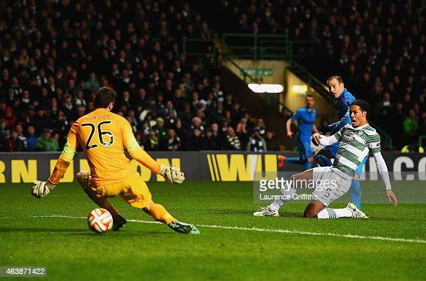 Rodrigo Palacio of Inter Milan shoots past goalkeeper Craig Gordon and Virgil van Dijk of Celtic to score their second goal during the UEFA Europa...