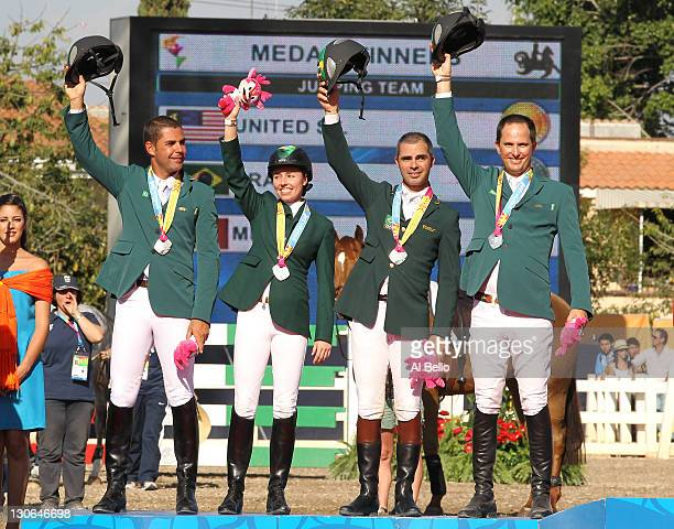 Rodrigo Pessoa Karina Johannpeter Bernardo Alves and Alvaro de Miranda Neto of Brazil celebrate their silver medal in jumping during the Jumping...