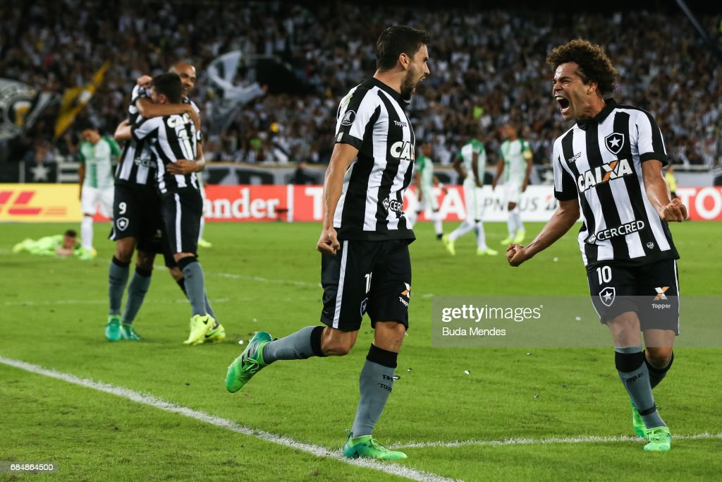 Rodrigo Pimpao (L) and Camilo of Botafogo celebrate a scored goal against Atletico Nacional during a match between Botafogo and Atletico Nacional as part of Copa Bridgestone Libertadores 2017 at Nilton Santos Olympic Stadium on May 18, 2017 in Rio de Janeiro, Brazil.