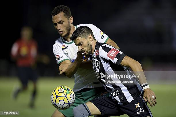 Rodrigo Pimpao of Botafogo battles for the ball with Willian Thiego of Chapecoense during the match between Botafogo and Chapecoense as part of...