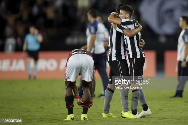 Rodrigo Pimpão and Matheus Fernandes celebrete the victory after the match between Botafogo and Flamengo as part of Brasileirao Series A 2018 at...