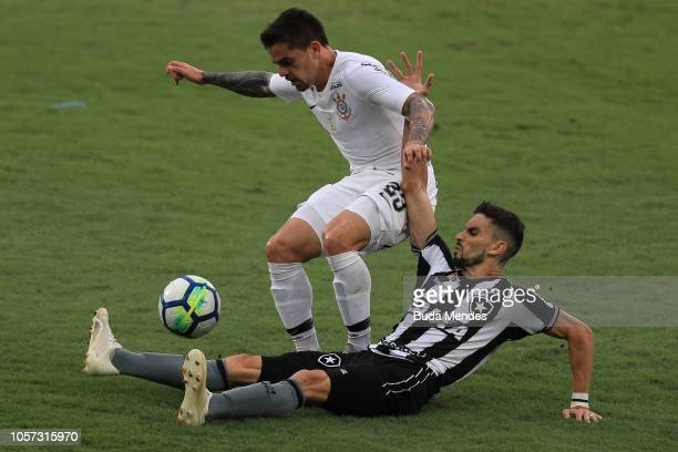 Rodrigo Pimpão of Botafogo struggles for the ball with Fagner of Corinthians during a match between Botafogo and Corinthians as part of Brasileirao...