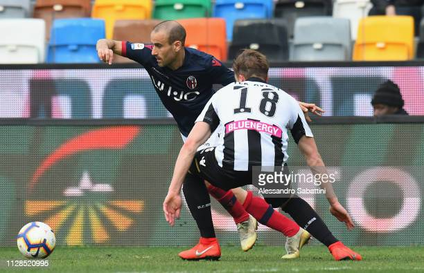 Rodrigo Plalacio of Bologna FC competes for the ball with Hidde Ter Avest of Udinese Calcio during the Serie A match between Udinese and Bologna FC...