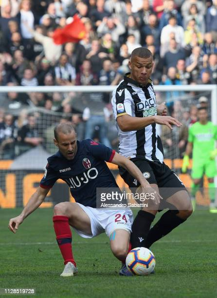Rodrigo Plalacio of Bologna FC competes for the ball with William Ekong of Udinese Calcio during the Serie A match between Udinese and Bologna FC at...