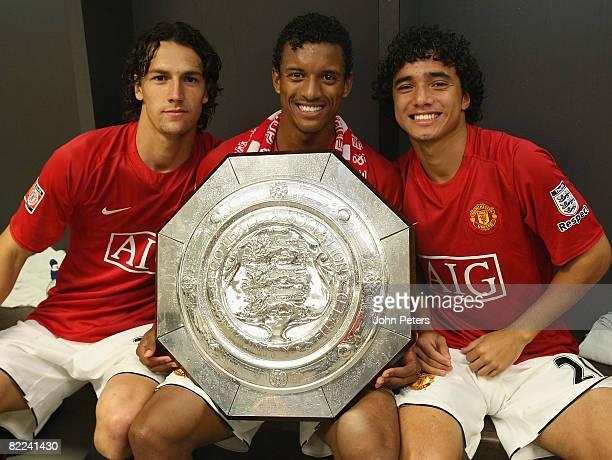 Rodrigo Possebon, Nani and Rafael Da Silva of Manchester United pose with the FA Community Shield in the dressing room after the FA Community Shield...