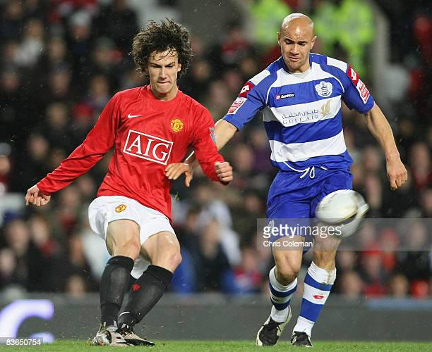 Rodrigo Possebon of Manchester United clashes with Gavin Mahon of Queens Park Rangers during the Carling Cup Fourth Round match between Manchester...