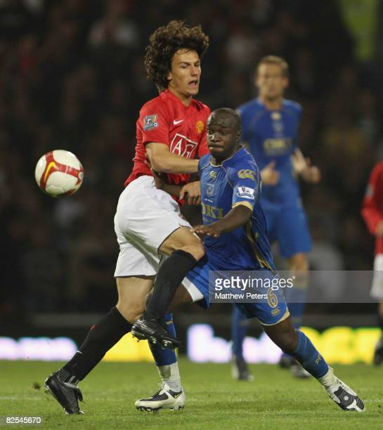 Rodrigo Possebon of Manchester United clashes with Lassana Diarra of Portsmouth during the FA Premier League match between Portsmouth and Manchester...