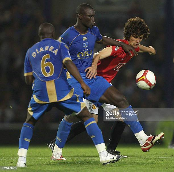 Rodrigo Possebon of Manchester United clashes with Pape Bouba Diop of Portsmouth during the FA Premier League match between Portsmouth and Manchester...