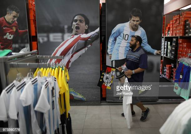 Rodrigo Prego shops at the Soccer Locker store for German soccer team items as he prepares to show his support for his favorite World Cup soccer team...