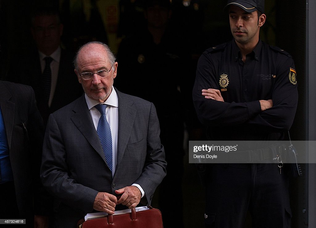 Rodrigo Rato, former chairman of rescued bank Bankia and former head of the International Monetary Fund, leaves Madrid's High Court where he answered allegations of misusing company credit cards on October 16, 2014 in Madrid Spain. Judge Fernando Andreu is questioning Rato along with former Bankia chief Miguel Blesa and former financial director Ildefonso Sanchez Barcoj.