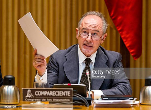 Rodrigo Rato the former chairman of Bankia SA waves documents as he speaks before a parliamentary committee in Madrid Spain on Thursday July 26 2012...