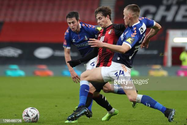 Rodrigo Riquelme of AFC Bournemouth is challenged by Ben Garrity of Oldham Athletic and Tom Hamer of Oldham Athletic during the FA Cup Third Round...