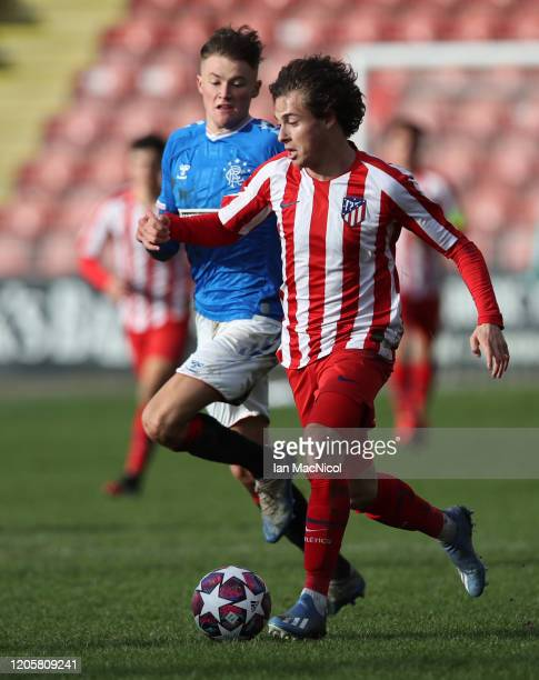 Rodrigo Riquelme of Athletico Madrid evades Nathan Patterson of Rangers during the UEFA Youth League match between Rangers U19 and Atletico Madrid...