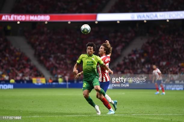 Rodrigo Riquelme of Atletico Madrid battles for possession with Takashi Inui of SD Eibar during the Liga match between Club Atletico de Madrid and SD...
